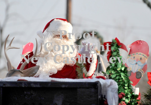 Courtney Caughey-Stambul/NEWS<br /> Santa Claus waves to spectators from his float on Saturday.