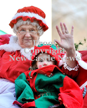 Courtney Caughey-Stambul/NEWS<br /> Mrs. Claus waves to the crowd gathered at Wampum's annual Christmas parade on Saturday.