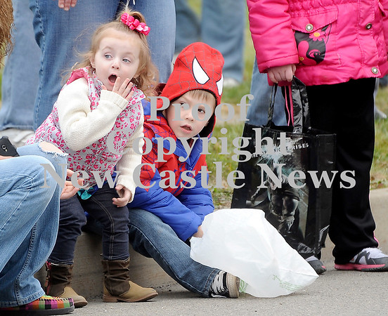 Courtney Caughey-Stambul/NEWS<br /> Madison Bennett, 2, left, and Everrett Curry, 4, react as balloons and confetti are released into the air, signaling the start of Wampum's Christmas parade.