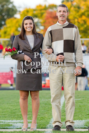 Scott R. Galvin / NEWS<br /> Mohawk High School homecoming court member Hannah Morrow is escorted on the field by her father Ted at the football game Friday.
