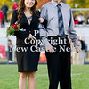 Scott R. Galvin / NEWS<br /> Mohawk High School homecoming court member Kelly LaMont is escorted on the field by her father Mark at the football game Friday.