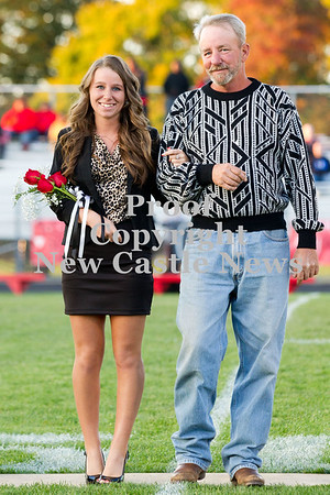 Scott R. Galvin / NEWS<br /> Mohawk High School homecoming court member Jessica Woods is escorted on the field by her father Jerry at the football game Friday.