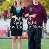 Scott R. Galvin / NEWS<br /> Mohawk High School homecoming court member Paige Crist is escorted by her father Anthony on the field at the football game Friday. Crist was crowned Homecoming Queen.