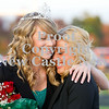 Scott R. Galvin / NEWS<br /> Mohawk High School homecoming queen Paige Crist, left, is congratulated by Casey Boyer at the football game on Friday.