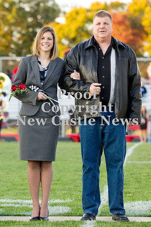 Scott R. Galvin / NEWS<br /> Mohawk High School homecoming court member Shannon Verlotte is escorted on the field by her father Brett at the football game Friday.
