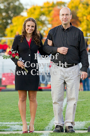 Scott R. Galvin / NEWS<br /> Mohawk High School homecoming court member Natalie Novad is escorted on the field by her father Mike at the football game Friday.