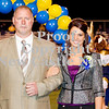 Scott R. Galvin / NEWS<br /> Wilmington Area High School homecoming court member Carly Wilson is escorted by her father Todd during during halftime of the football game on Friday.