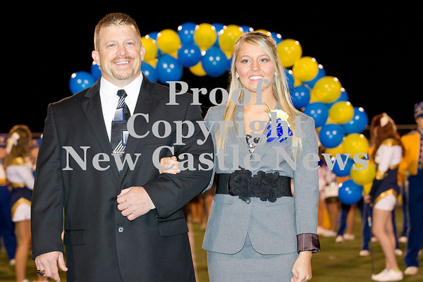 Scott R. Galvin / NEWS<br /> Wilmington Area High School homecoming court member Alexis Crawford is escorted by her father Mike during halftime of the football game on Friday.