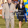 Scott R. Galvin / NEWS<br /> Wilmington Area High School homecoming court member Macy Soltis is escorted by her father Brian during halftime of the football game on Friday.