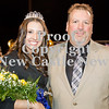 Scott R. Galvin / NEWS<br /> Wilmington Area High School homecoming court member Macy Soltis is escorted by her father Brian during halftime of the football game on Friday.  Soltis was crowned homecoming queen.