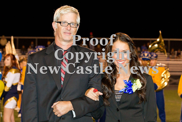 Scott R. Galvin / NEWS<br /> Wilmington Area High School homecoming court member Kathryn Chase is escorted by her father Mark during halftime of the football game on Friday.