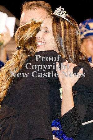 Scott R. Galvin / NEWS<br /> Macy Soltis gets a congratulatory hug during halftime of the football game on Friday.  Soltis was crowned the Wilmington Area High School homecoming queen.