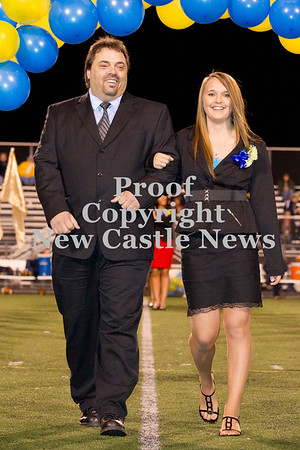 Scott R. Galvin / NEWS<br /> Wilmington Area High School homecoming court member Taylor Anderson is escorted by her father Frank during halftime of the football game on Friday.