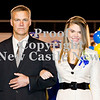 Scott R. Galvin / NEWS<br /> Wilmington Area High School homecoming court member Abby Sotter is escorted by her father Chris during halftime of the football game on Friday.