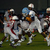 Erica Galvin/NEWS<br /> New Castle's Malik Hooker (23) and Levar Ware tackle Central Valley's Robert Foster for a turnover on downs.
