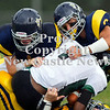 Scott R. Galvin / NEWS<br /> <br /> Shenango's Brian Tanner, left, and Tyler Welsh, right, bring down Sto-Rox's running back Brendan Bkaur in the first quarter on Saturday.