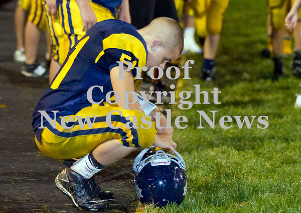 Scott R. Galvin / NEWS<br /> <br /> Shenango's Trent Burkes (51) squats on the sidelines during the closing minutes of Saturday's 38-20 loss to Sto-Rox.