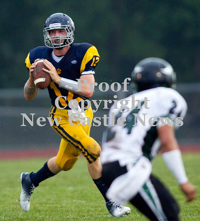 Scott R. Galvin / NEWS<br /> <br /> Shenango quarterback Brian Tanner (#12) looks down-field for the pass during the first quarter of against Sto-Rox on Saturday.