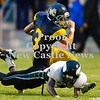 Scott R. Galvin / NEWS<br /> <br /> Shenango running back Tyler Welsh (3) gets tackled by Sto-Rox's Braig Johnson during the second quarter of Saturday's game.