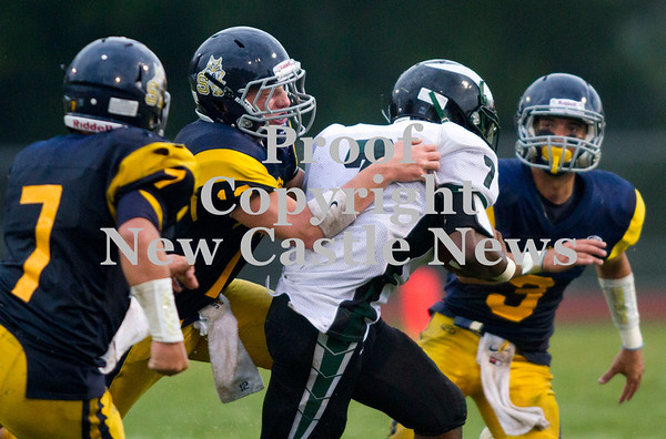 Scott R. Galvin / NEWS<br /> <br /> Shenango's Brian Tanner (12) brings down Sto-Rox runningback Brendan Bkaur with help from teammates Anthony Prestopine (7) and Tyler Welsh (3) during the first quarter on Saturday.