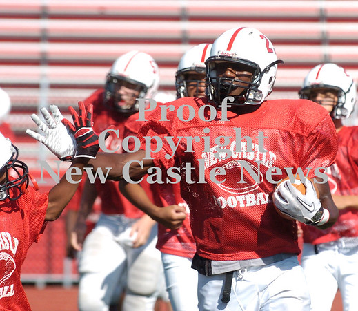 Erica Galvin/NEWS<br /> Malik Hooker stiff arms a teammate during a drill at practice.