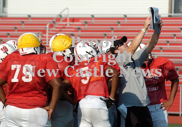 Erica Galvin/NEWS<br /> New Castle head coach Joe Cowart calls a play into the offense during a drill at practice.