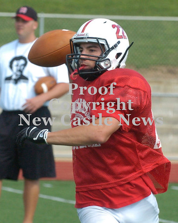 Erica Galvin/NEWS<br /> Anthony Richards looks downfield for an open teammate during last week's practice.