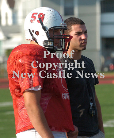 Erica Galvin/NEWS<br /> Injured player Anthony Richards stands on the sidelines with Mark Benn, (59) during practice this week.