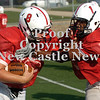 Erica Galvin/NEWS<br /> New Castle freshman quarterback Pat Minenok takes on Jamal Moody during practice.