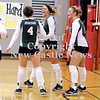 Courtney Caughey-Stambul/NEWS<br /> Laurel players celebrate after scoring a big point against Neshannock. From left: Morgan Ritchie, Leah Telesz and Allie Collier.