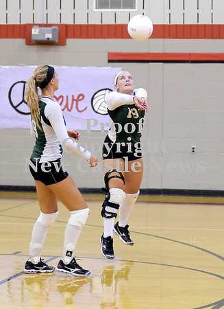 Courtney Caughey-Stambul/NEWS<br /> Rachael Baker bumps the volleyball over the net for Laurel as teammate, Leah Telesz, looks on.