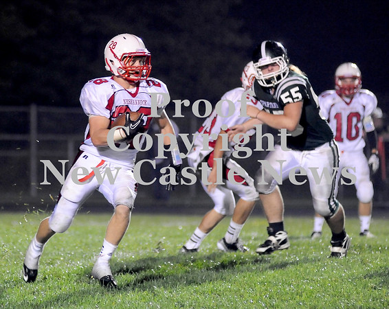 Courtney Caughey-Stambul/NEWS<br /> Neshannock's Alex Welker runs the football as Laurel's Kyle Brightshue closes in.