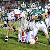 Courtney Caughey-Stambul/NEWS<br /> Laurel's Dalton Rosta fights for yards against Neshannock's John Conglose (21) and Steve Senko (52).