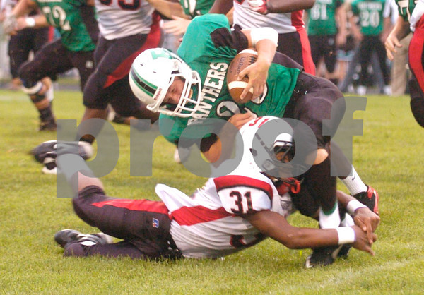Erica Galvin/NEWS<br /> New Castle's Tevin McCaster tackles Riverside's Bob Gould in the first quarter.