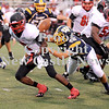 Courtney Caughey-Stambul/NEWS<br /> Wilmington's Riley Kollar knocks the football loose from Hickory running back DeShawn Coleman.