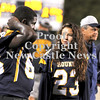 Courtney Caughey-Stambul/NEWS<br /> Wilmington's Kyler Lum, right, talks on the sideline with teammate, Nasir Watson, on Friday night during the Greyhounds' game against Hickory.