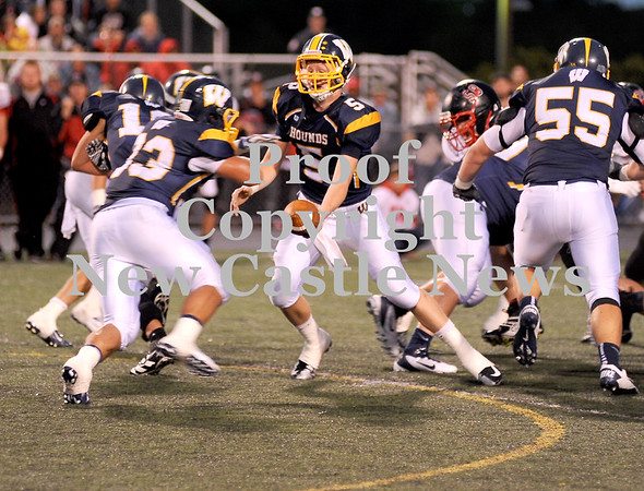 Courtney Caughey-Stambul/NEWS<br /> Wilmington quarterback Cody Llewellyn hands off to Tyler Donati last night against Hickory.