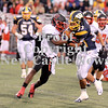 Courtney Caughey-Stambul/NEWS<br /> Wilmington's Tyler Donati fights for extra yards against Hickory's DeShawn Coleman.