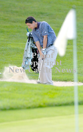Erica Galvin/NEWS<br /> Shenango golfer Lucas Villani hits the ball out of the sand towards the flag during the TriCounty Golf Tournament.