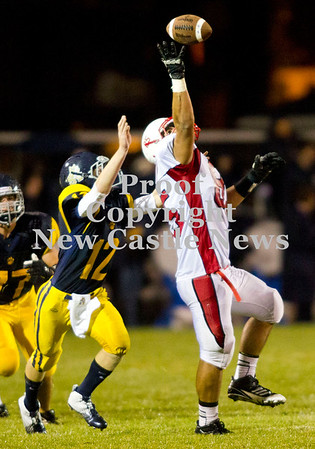 Scott R. Galvin / NEWS<br /> <br /> Neshannock tight end Steven Jeffries (85) reaches to make the reception against Shenango defensive back Brian Tanner (12) during the first quarter Saturday.