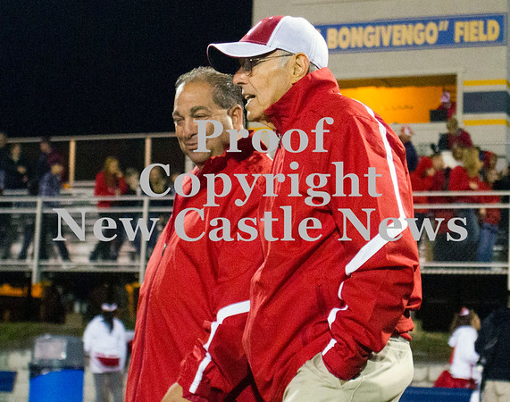Scott R. Galvin / NEWS<br /> <br /> Neshannock assistant coaches Frank Bongivengo talk following the team's 49-6 win over Shenango on Saturday.  The football field at Shenango High School was named in Bongivengo's honor.
