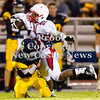 Scott R. Galvin / NEWS<br /> <br /> Neshannock's Mike Rodriguez (12) gets tackled by Shenango's Hunter Miller (20) during the second quarter on Saturday.