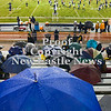 Scott R. Galvin / NEWS<br /> <br /> Fans escape the rain under their umbrellas while watching the Shenango marching band during the half-time show on Saturday.