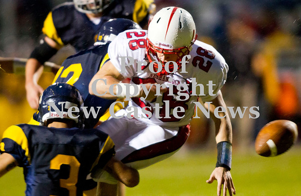 Scott R. Galvin / NEWS<br /> <br /> Shengango defensive back Tyler Welsh (3) causes Neshannock wide receiver Alex Welker (28) to fumble during the first quarter Saturday.  Shenango recovered the ball.