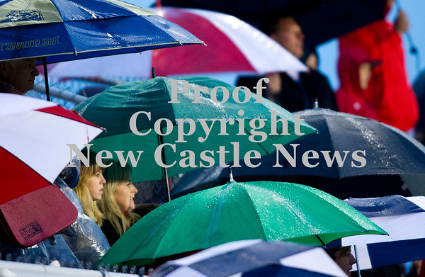 Scott R. Galvin / NEWS<br /> Fans huddle under their umbrellas as the rain pours down Saturday night during the Neshannock at Shenango football game.