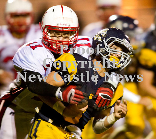 Scott R. Galvin / NEWS<br /> <br /> Shenango running back Tyler Welsh (3) is tackled by Neshannock's Gianni Olivia (11) during the second quarter of Saturday's game.