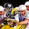 Scott R. Galvin / NEWS<br /> <br /> Shenango quarterback Brian Tanner (12) gets sacked by Neshannock's Steven Jeffries (85) and Ralph Dovidio (50) in the second quarter of Saturday's game.