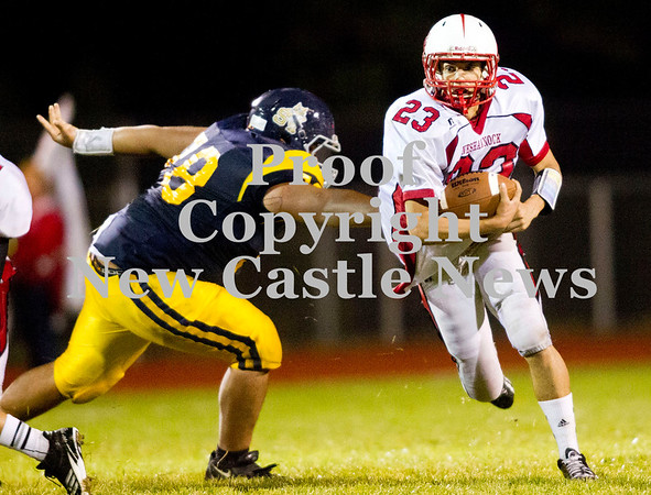 Scott R. Galvin / NEWS<br /> <br /> Neshannock's Eli Owens (23) runs the ball past Shenango's Alonzo Regna (78) during the second quarter on Saturday.