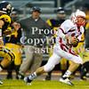 Scott R. Galvin / NEWS<br /> <br /> Neshannock quarterback Ernie Burkes (10) runs the ball past Shenango defensive back Tyler Root (22) during the first quarter Saturday night.