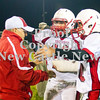 Scott R. Galvin / NEWS<br /> <br /> Neshannock players congratulate assistant coach Frank Bongivengo following the team's 49-6 victory over Shenango on Saturday.  The football field at Shenango High School was named in Bongivengo's honor.